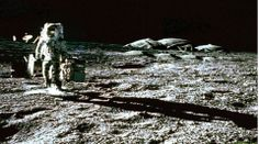 On the Moon.  Alien Base in the background.