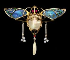 Art Nouveau moth brooch by Emil Riester, enamelled with pearls and rubies, ca.1905.