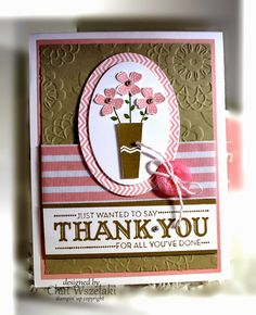 Lovely Lace embossing folder sets the background for this vase of pink flowers. Broad striped ribbon and a designer button finish this handmade thank you card.