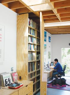 Designed by Jagoda, the door swings open to fit in front of a bookshelf. Photo by: Zen Sekizawa