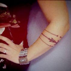 band style Arrow tattoo, arm tattoo