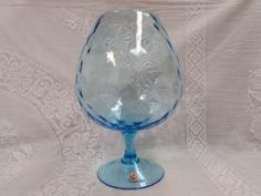"Ice Blue Optic Glass Balloon Vase. This brandy snifter style vase was made in Italy. It has a diamond optic pattern on it. The glass is hand blown. It stands approx. 8 3/4"" tall x 3 1/8"" opening. This vase dates to the around the 60's."
