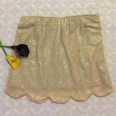 Creme Sequined Mini Skirt Stunning Creme sequined skirt in excellent condition. No damage. Super chic and stylish. Brand: UMGEE Coveted Clothing Skirts Mini