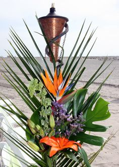Tiki Torch Florals used for Beach Wedding Aisle - Simply Regal by Julie