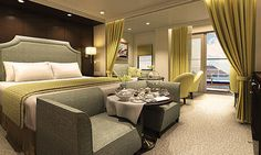 What a brilliant layout especially the seating at the tip of the bed.  /oceania/marina-penthouse-suite.jpg