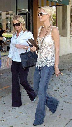 Paris Hilton carrying a Louis Vuitton Agenda