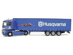 Universal Hobbies 1:50 Renault Magnum Diecast Model Lorry - 5681 This Renault Magnum with Krone Husqvarna Trailer Diecast Model Lorry is Blue and features working wheels and also opening trailer doors. It is made by Universal Hobbies and is 1:50 scale (approx. 35cm / 13.8in long).  #UniversalHobbies #ModelLorry #Renault