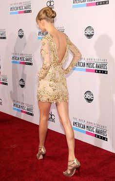 Taylor Swift's perfection from the back. Legs Legs, heels, hair. PERFECT.