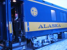 Train conductor in Alaska, saying good bye as the train leaves.