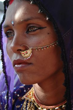 India |  Portrait of Pupa.  When photographed she was selling trinkets from her stall in Pushkar.  Rajasthan | © Stuart Cohen