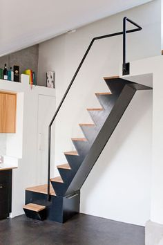 Compact staircase with storage under the first step.