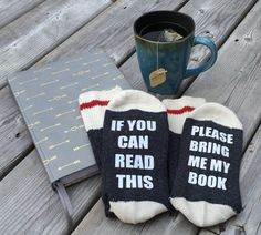These adorable bookish socks would be the perfect gift for book lovers!