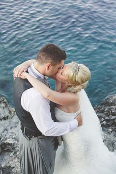 Stunning 'Just Married' kiss by the clear blue sea in Cyprus.  Image by Chantal Lachance-Gibson Photography.