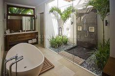 beautiful light bright balinese bathroom slate pebbles and darkwood                                                                                                                                                      More