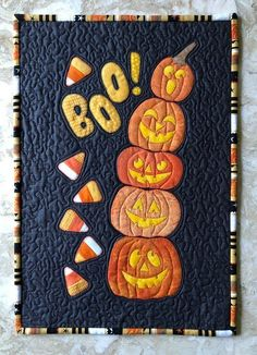 Boo! The Halloween wall quilt or door hanging may not be scary, but its bright, colorful and lots of fun. The jack-o-lanterns with their individual faces and the topsy-turvy candy corn, combine to make a delightful decorative piece for the autumn holiday. The finished measurements are 14 1/2 x 21. Halloween Quilt Patterns, Halloween Sewing Projects, Halloween Quilts, Halloween Cards, Halloween Door, Halloween Table, Halloween Applique, Halloween Magic, Halloween 2017