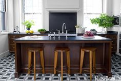 Modern Victorian House - The star of the kitchen is the Moroccan encaustic tile from Amethyst Artisan. The custom barstools were inspired by Swiss architect Pierre Jeanneret. Easton faucet by Waterworks. Wolf range.