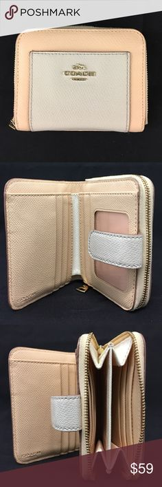 "COACH - Medium zip around wallet in bicolor Authentic Coach wallet with pretty bicolor Apricot/Chalk cross grain leather. Features ten credit card slots, multifunction pockets, full-length bill compartments, zip coin pocket, ID window. Zip-around closure. Approximately 3/4"" (L) x 3 3/4"" (H). Shows little signs of usage, but in overall great condition. Coach Bags Wallets"