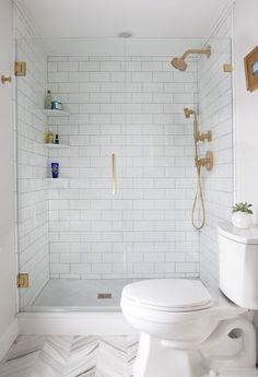 Brass and subway tile. Nice design walk in shower for a small bathroom #brass #SmallBathroom #BathroomDesign