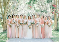 Bride with her 10 bridesmaids in mismatched blush bridesmaid dresses at a Charleston, SC wedding!    *** Aaron and Jillian Photography