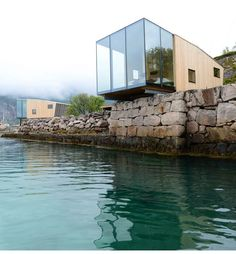 17 of the best new buildings in the world, according to architecture experts - BEST HOTEL/RESORT: Manshausen Island Resort, a hotel in the Steigen Archipelago off the coast of Northern Norway. Resorts, Cantilever Architecture, Eco Architecture, Glass Cabin, Glass House, Norway Fjords, Station Balnéaire, Island Resort, Cabin Rentals