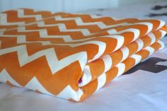 Cuddle Blanket Chevron Delight. Popular Chevron Pattern in array of colour. A Soft Minky Fleece Fabric for warmth and softness. Perfect for cots, nurseries, prams. (Gifts for Baby, Baby Shower Gifts / Gifts for child). #chevron #orangepink #snuggle #blanket #babyblanket #nursery #kidsroom #bedtime #pramaccessory #cuddle #blanket #littledreamer #