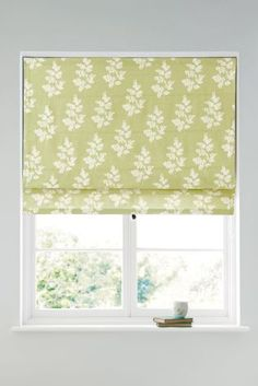 Changing up your blinds is a great way of refreshing your home in time for the spring season. We adore this country sprig print roman style from Next.