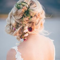 The 7 Best Instagram Accounts For Major Hair Inspiration: soft, romantic updo with flowers by @stephanieannb | allure.com