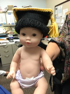 Looking for someone who could make a pattern for this hat. Knitted or crocheted. HELP. I have people to make them I just need a pattern.