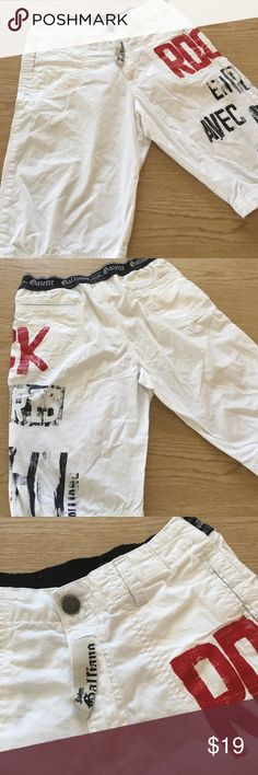 Super Cool JOHN GALLIANO Cotton Shorts JOHN GALLIANO Boys White Cotton Shorts.  Size 12. Side Pockets. Belt Loops. 2 Back Pockets. Probably Just Wore Once. Has 2 tiny yellow dots on rear hardly noticeable & not at all when on. John Galliano Bottoms Shorts