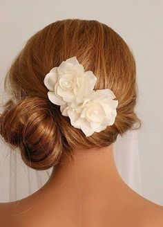Side Bun With Flower Bridesmaid Hairstyles For Long Hair-- minus flower?