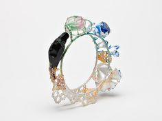 "Nina Oikawa -AUSTRALIA ""My work investigates jewellery making possibilities and the relationships of resin casting informed by a curiosity towards materials and spatial relationships."""