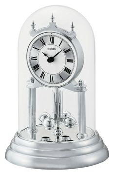 Our parents had one of these mantel clocks in brass when we were growing up. We like this one in silver. Seiko rotating pendulum mantel clock.