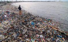 A Fisherman on the coast, Semarang, Java #Indonesia #plasticpollution