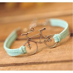 Like to Bike? This cute bicycle charm bracelet has a leather band and the bike charm is made from zinc alloy. Available in Brown, Pink or Mint Green.