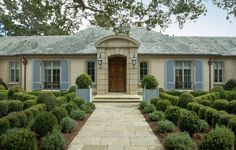 entrance to French Country House ... love the color palette and the varied boxwood planting
