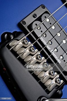 the-bridge-and-pickup-of-a-parker-dragonfly-df524-electric-guitar-a-picture-id153901243 (395×594)