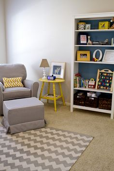Add interest to a plain bookcase by painting the interior a bold color. #nursery