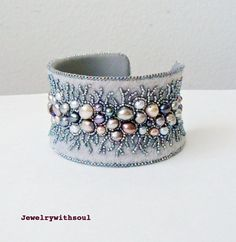 63 pearls! This delicate bracelet is stitched on the grey felt, I used freshwater pearls of different tones of greys - silver, gunmetal, pea...