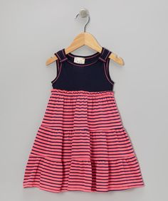 This darling tiered treat has ladies looking sweet! A soft and stretchy fabric ensures comfiness on days of play, while a full skirt and classic colors ensure it stays in style.