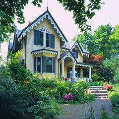 Victorian Trim-Decorative bargeboard trim laces the eaves of this Victorian-style home. All dressed up, the outdoor scheme includes historically-accurate paint colors and a new landscape plan of cottage-garden plants and red brick.