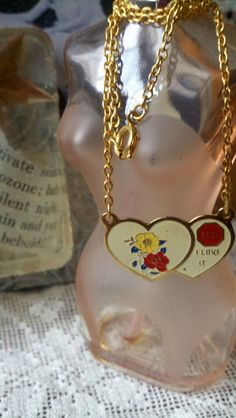 Love necklace by MagentaD on Etsy, $5.00