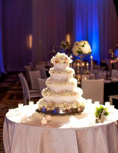 The wedding cake was topped with fresh flower petals that complemented the ivory blooms used throughout the wedding: hydrangeas, roses, peonies, and orchids. #FloralWeddingCake Photography: Mi Belle Photographers. Read More: http://www.insideweddings.com/weddings/adrianna-costa-and-scott-gorelick/531/#.VXCWtOU27TQ.gmail
