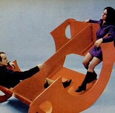 One piece of furniture is a table, playhouse, bar, and multi-person rocker, 1970