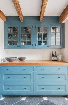 13 New Kitchen Trends - light blue cabinets, butcher block countertop, exposed beams, glass front cabinets - interno & esterno Farmhouse Kitchen Cabinets, Kitchen Cabinet Design, Kitchen With Blue Cabinets, Kitchen Cabinetry, Painted Kitchen Cabinets, Pantry Cabinets, Pantry Doors, Farmhouse Sinks, Farmhouse Kitchens