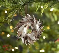Get in the holiday spirit with Christmas ornaments and Christmas tree decorations from Pottery Barn. Decorate your tree and enjoy the holiday season. California Christmas, Southern Christmas, Feather Wreath, Feather Crafts, Feather Art, Diy Christmas Ornaments, Christmas Tree Decorations, Mannequin Christmas Tree, Holiday Tree