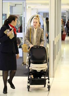 Baby on board! Melissa George, 39,stepped out at Sydney airport ahead of her flight back ...