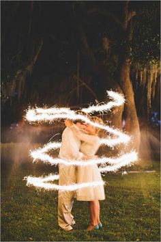 Lovely photo idea - couple circled with a sparkler captured on a slow shutter speed