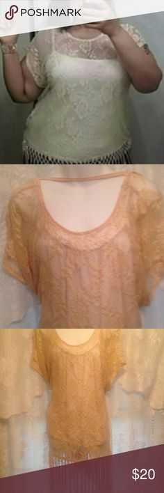 Gorgeous Gold Lace Crochet Gold top sz 2x/3x This is a New lace crochet Fringe top sz 2x. Top looks sort of like a Gold color. Truest color is in photo 4., but it's still prettier gold than that!! Very comfortable and loose. 52 inches across the chest lying flat. Tag says 2x, but I would say may fit a 3x because it is too big for me and I normally wear a 2x. Tank not included. Gorgeous lace and beautiful gold fringe at the bottom. Photos don't do this justice!!! Tops