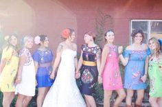 Oh my gosh this is so cute!!! I would totally consider doing this if I were still planning my own wedding.  The bridesmaids all wore different colored Mexican dresses with cowboy boots.  Then the groomsmen could wear Guybayera shirts!
