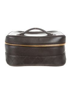 Black leather Chanel quilted vanity case with gold-tone hardware, handle at top, one slit pocket at interior walls and zip closure at top. Serial number reads 4504558.